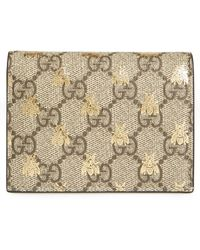 fc34693103a Lyst - Gucci Bee Gg Supreme Card Holder in Metallic