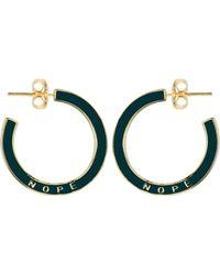 1f56dfdc7 Kris Nations Rainbow Pave Huggie Hoop Earrings in Metallic - Lyst