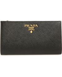 527c19fb611 Prada Daino Small Zip Around Leather Wallet in Orange - Lyst