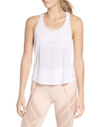 c9e8d2abf93e9 Lyst - Alo Yoga Haven Turtleneck Sleeveless Sport Tank in White