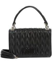 Miu Miu - Matelasse Quilted Lambskin Leather Top Handle Bag - Lyst