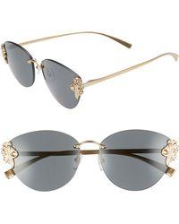92dfd35fecbf Prada PR 51TS LAX6O2 Black Antique Gold Metal Cat-Eye Sunglasses Violet  Lens Women s Accessories