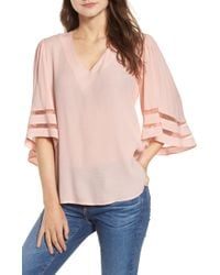 c7d31a5bc392ff Lyst - Astr Pleated Long Sleeve Surplice Top in Red - Save 42%