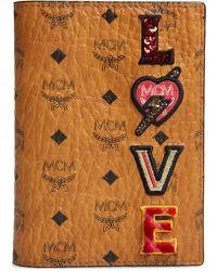 65f4b864a MCM - Love Patch Visetos Passport Holder - Lyst