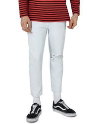 TOPMAN - Tapered Fit Ripped Jeans - Lyst
