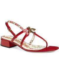 5a16090d9ff6 Lyst - Gucci Bee Embellished Slide Sandal