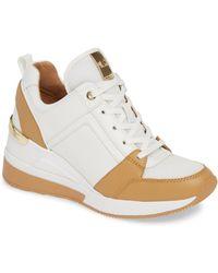 5c893bef277 Lyst - MICHAEL Michael Kors Georgie Wedge Sneaker in Brown