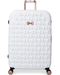Ted Baker - Large Beau Bow Embossed Four-wheel 31-inch Trolley Suitcase - - Lyst