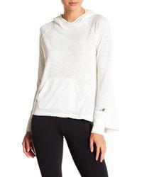 New Balance - Hooded Long Sleeve Top - Lyst