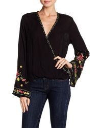 Love Stitch - Embroidered Bell Sleeve Surplice Neck Blouse - Lyst