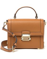 3963bce859f0 Lyst - MICHAEL Michael Kors Jayne Small Studded Leather Trunk Bag in ...