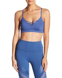 10a22ea6d084b Lyst - Alo Yoga Interlace Sports Bra in Blue