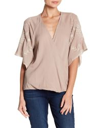 Love Stitch - Embroidered Surplice Neck Blouse - Lyst