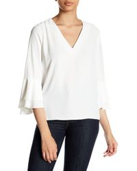 Fate - V-neck Bell Sleeve Blouse - Lyst