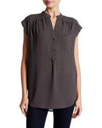 d6dfb912903ed6 Lyst - Pleione Cap Sleeve Pleat Back Blouse in Black