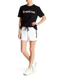Bebe - Stitched Logo Dolphin Shorts - Lyst