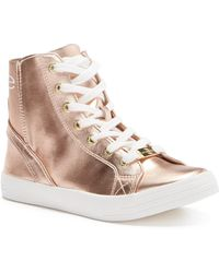 00125d8f6f4 Lyst - Bebe Colby Wedge Sneaker in White