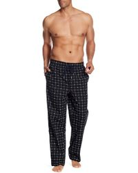 Lacoste - Signature Print Trousers - Lyst