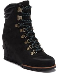 Sorel - Conquest Waterproof Leather Wedge Boot - Lyst