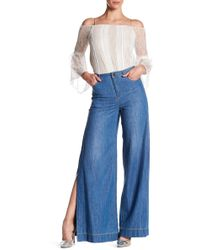Alice + Olivia - Clarissa Wide Leg Side Split Jeans - Lyst