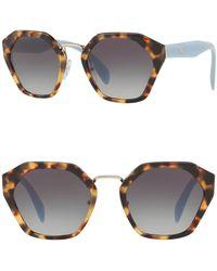 01bb61431a Lyst - Prada Women s Cat Eye Plastic Frame Sunglasses