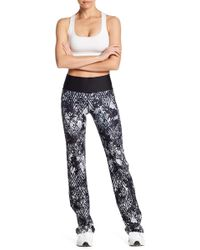Warrior by Danica Patrick Active - Flare Leg Leggings - Lyst