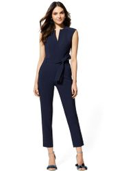 e7fb357534ff Lyst - New York   Company Navy Zip-front V-neck Jumpsuit in Blue