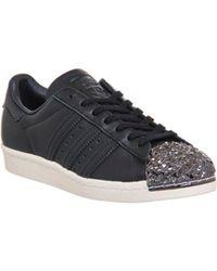 Adidas superstar degli anni '80 i formatori 3d originali di metallo nero / core core