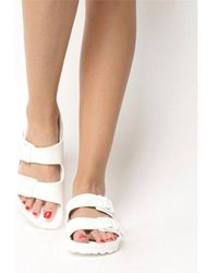 57a0e5ac79c5 Lyst - Urban Outfitters Birkenstock Mayari Toehold Sandal in Metallic