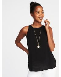 0a0b4893354e53 Lyst - Old Navy Maternity Sleeveless High-neck Swing Top in Black