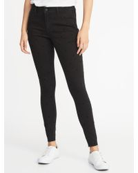 Old Navy - Mid-rise Raw-edge Rockstar Jeans - Lyst