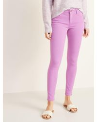 8de76ce7dc Old Navy Mid-rise Pop-color Raw-edge Rockstar Ankle Jeans in Pink - Lyst