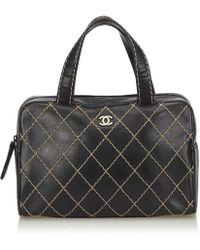 Chanel - Surpique Leather Handbag - Lyst