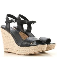 06ddb10c5f00 Lyst - Michael Kors Ryder Wedge Sandals in Black