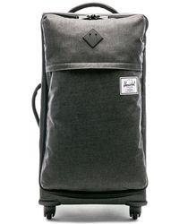 4511bb5853b Lyst - Herschel Supply Co.  highland  Suitcase in Black