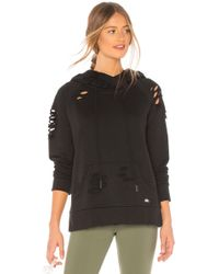 Alo Yoga - Ripped Hoodie In Black - Lyst