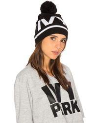 Ivy Park - Logo Pom Beanie In Black. - Lyst