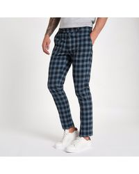 River Island - Navy Check Print Skinny Smart Trousers - Lyst