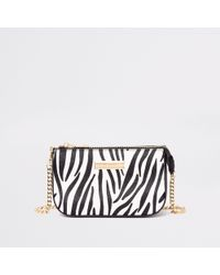 8df78c474416d River Island - Zebra Print Mini Chain Shoulder Bag - Lyst