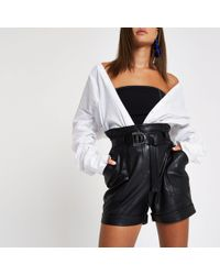 River Island - Black Faux Leather Paperbag Waist Shorts - Lyst