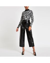 River Island - Vinyl Belted Wide Leg Pants - Lyst