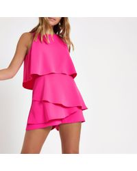 River Island - Petite Bright Pink Tiered Sleeveless Playsuit - Lyst