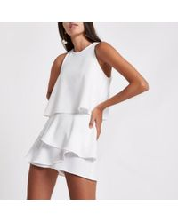 River Island - White Tiered Frill Sleeveless Playsuit - Lyst
