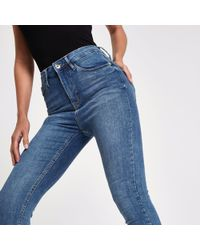 River Island - Mid Blue Harper High Waisted Skinny Jeans - Lyst