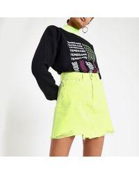 River Island - Neon yellow mini denim skirt - Lyst
