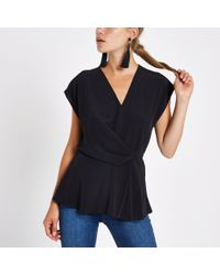 River Island - Black Wrap Tuck Front Blouse - Lyst