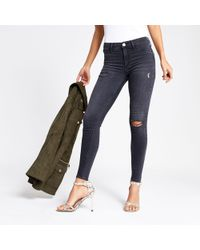 River Island - Molly Mid Rise Ripped jeggings - Lyst