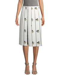 5a432396b Victoria Beckham - Grid And Floral Print Pleated Skirt - Lyst