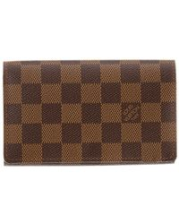 8e80dea5be80 Lyst - Louis Vuitton Damier Ebene Canvas Marco Wallet in Brown