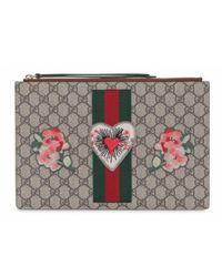 f996cb0e7 Gucci Embroidered Face Gg Supreme Wrist Wallet in Brown - Lyst